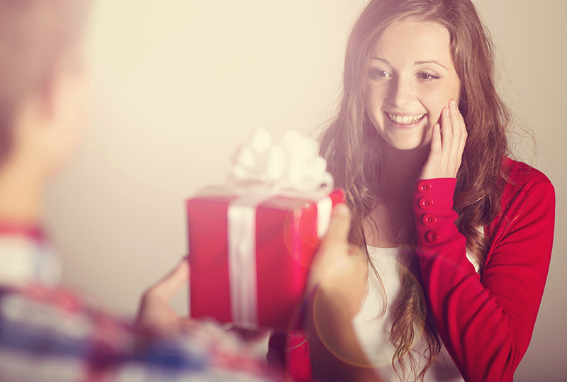 http://www.dreamstime.com/stock-images-man-handing-woman-gift-red-wrapped-to-beautiful-image34683694