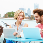 http://www.dreamstime.com/stock-images-couple-roof-terrace-using-laptop-digital-tablet-sitting-table-bike-background-image40094344